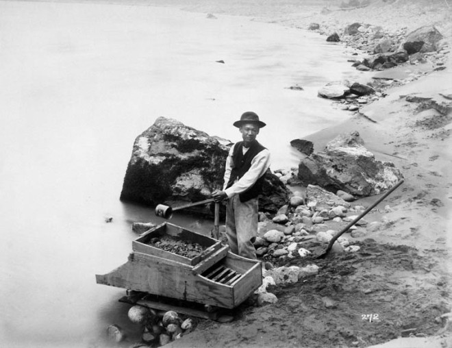 Chinese man panning for gold